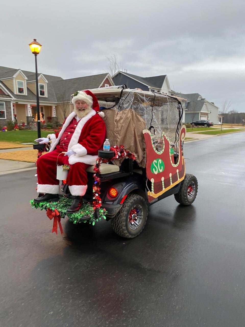 Santa Earl Riding in Golf Cart Sleigh
